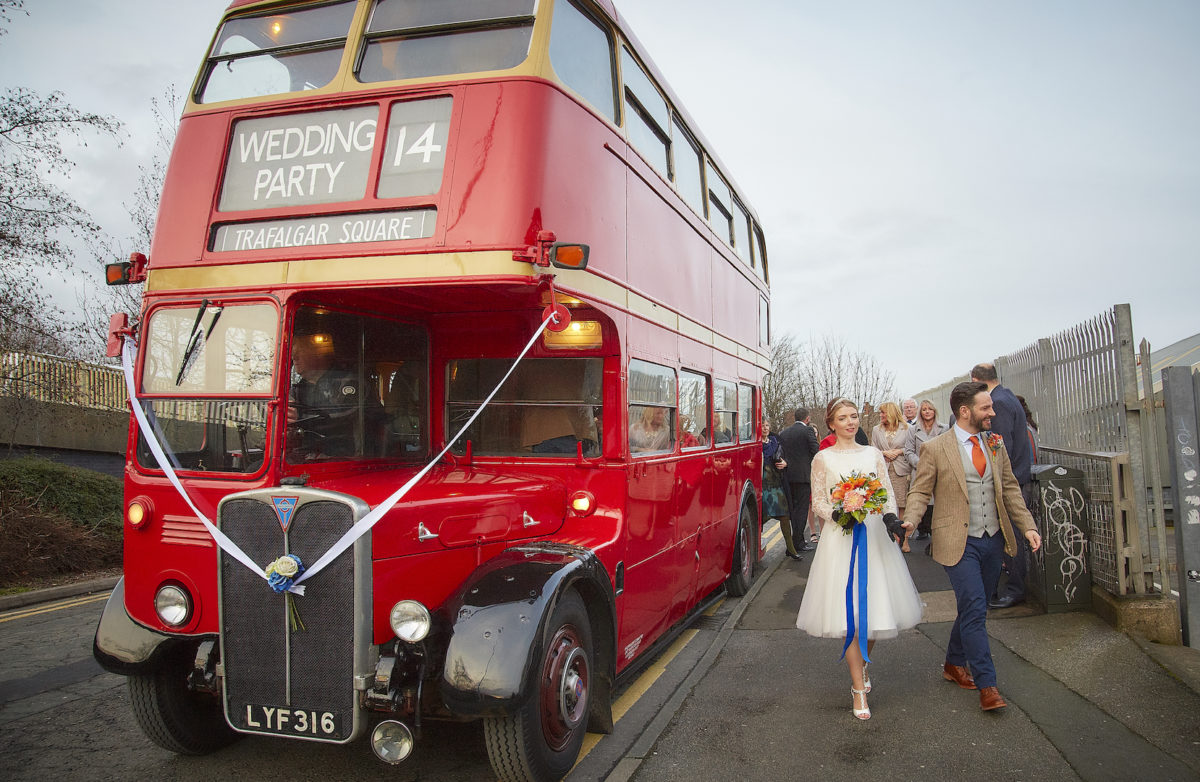 front of bus and bride & groom
